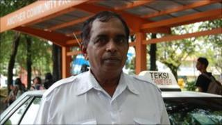61-year-old Sivananthan Mariappan drives a taxi after retiring