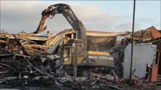 Demolition work at Kidderminster shops destroyed by fire
