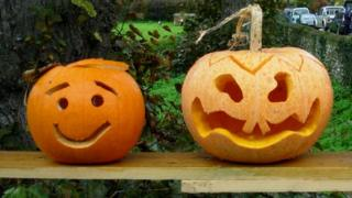 Two jack-o-lanterns made from pumpkins