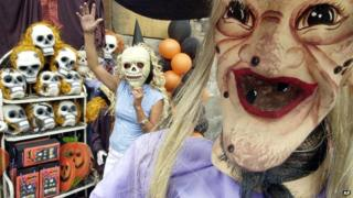 People dressed up in Halloween masks