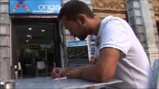 Man filling in OPAP lottery form