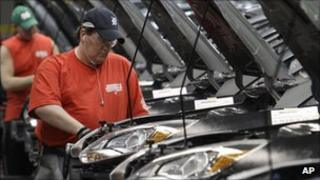 Workers assemble Ford Focus vehicles at the firm's plant in Wayne, Michigan