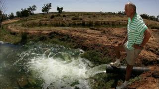 Farmer at water supply