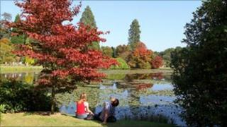 People enjoy the grounds of Sheffield Park in East Sussex