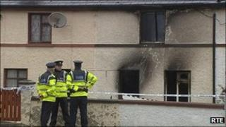 Irish police outside house