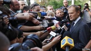 Polish Prime Minister Donald Tusk speaks to reporters in Warsaw, 26 September