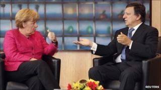 German Chancellor Angela Merkel (left) talks to European Commission President Jose Manuel Barroso