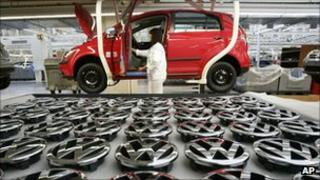 A worker assembles VW's Golf at its Wolfsburg plant