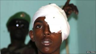 A victim of a suicide blast recuperates in Madina hospital in Mogadishu 5 October 2011