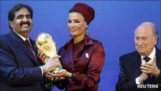 Qatar delegates celebrate after being awarded the 2022 World Cup hosting rights