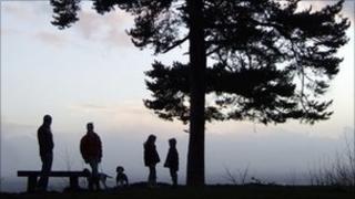 Family gathered near a tree