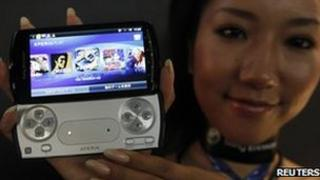 A model shows Sony Ericsson's Xperia PLAY phone