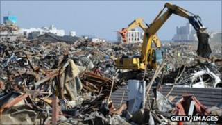Heavy machinery cleans up tsunami devastation in Japan