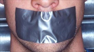 Mouth with tape over it