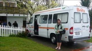 Gail beside the camper van
