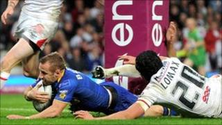 Rob Burrow of Leeds Rhinos scores the opening try against St Helens