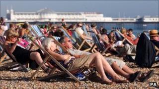 People enjoying last month's sunshine on the beach in Brighton