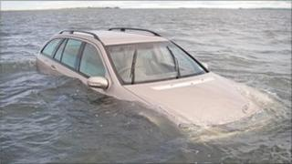 The car stranded on Holy Island causeway