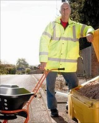 Dave Luckett, from Twyning Parish Council, standing with a hand spreader for salt
