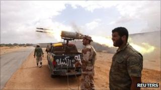 Anti-Gaddafi fighters fire C5 rockets during clashes with pro-Gaddafi forces in Sirte