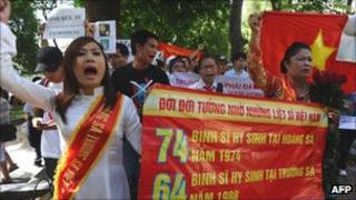Vietnamese anti-China protesters marching in Hanoi on 24 July 2011, remembering Vietnamese soldiers killed by the Chinese in the South China Sea.