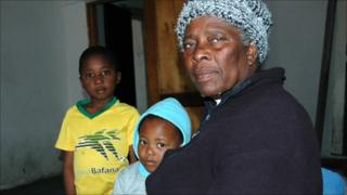 Angelina Maholwana and her grandchildren
