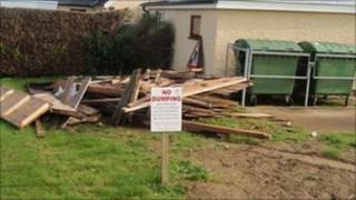 Wood dumped at Castlederg cemetery