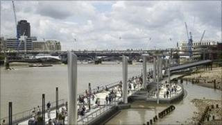 A computer-generated image of the walkways and floating barges spanning the north bank of the River Thames