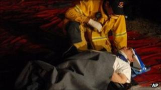 A firefighter with an injured man
