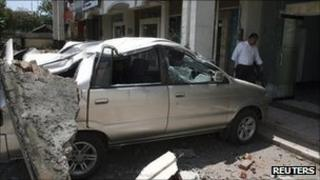 A car is crushed by falling debris caused by the earthquake in Bali on 13 October 2011