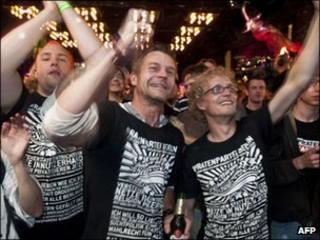 Supporters of the Pirate Party celebrate the Berlin regional election results at an election party in Berlin