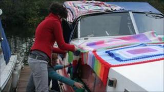 Boat covered in knitting, Milestones Trust