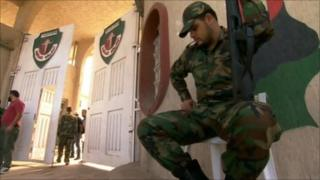 Guard at entrance to al-Judaida prison