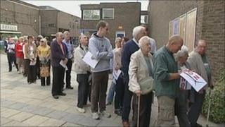 People queuing for the meeting at Swindon's Wyvern Theatre