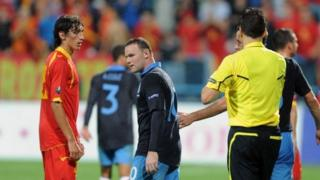 Wayne Rooney gets a red card during the match against Montenegro