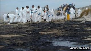 Soldiers continue clean-up operations on the Bay of Plenty coastline on New Zealand's North Island on Thursday, after more oil from the stricken vessel Rena washed up
