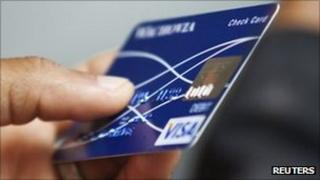 A man holds a bank card