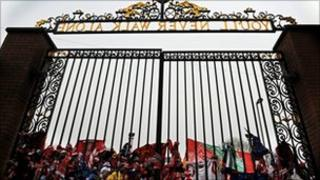 Football scarves tied to the Shankly Gates at Anfield