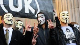 Protesters in Guy Fawkes masks