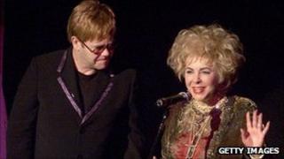 Dame Elizabeth Taylor with Sir Elton John in 2001