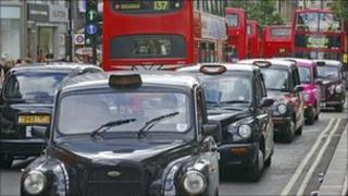 Taxis and buses in Oxford Street, central London