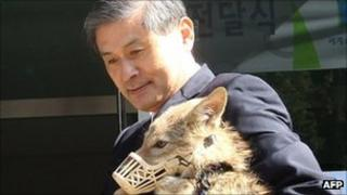 Hwang Woo-suk delivers a coyote to an animal shelter in South Korea on 17th October