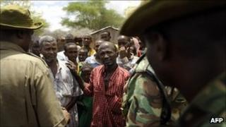 Kenyan security forces talk with residents at a village near near Liboi, Kenya's border town with Somalia on October 15