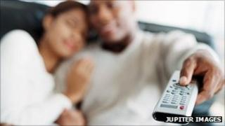 Couple with a TV remote. Pic: Jupiter Images