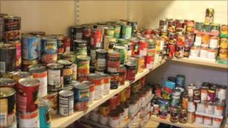 Tins being stored in Trinity Cheltenham's garage