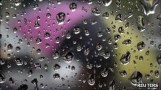 Raindrops on a window and an umbrella