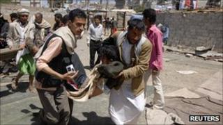 Wounded protester in Yemen carried for treatment