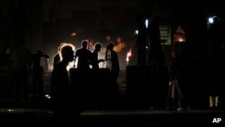 Anti-government protesters behind makeshift barriers in the western Shia village of Malkiya, Bahrain, 6 October 2011