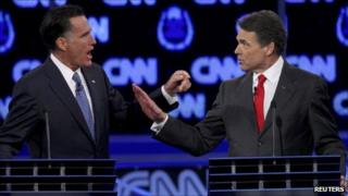Mitt Romney and Rick Perry in the CNN Republican debate on 18 October 2011