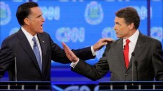 Mitt Romney (L) and Rick Perry debate in Las Vegas on 18 October 2011